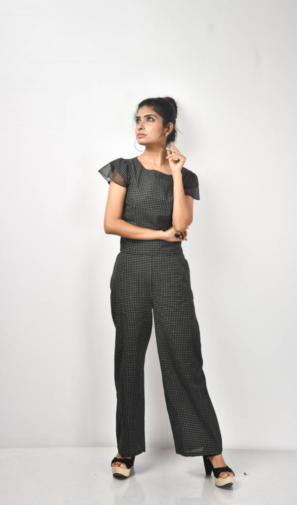A co-ordinate set in miniature checks. The sleeve is layered with organza to break the monotony